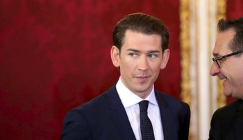 Sebastian Kurz, Austria's chancellor, left, and Heinz-Christian Strache, Austria's vice chancellor, look on during the inauguration of the new federal government in Vienna, Austria, on Monday, Dec. 18, 2017