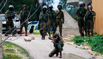 Israeli security forces hold position during clashes with Palestinian protestors in the village of Kfar Qaddum, near Nablus, in the occupied West Bank on March 3, 2017.