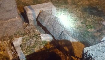 A toppled headstone at the Washington Cemetery in Brooklyn, New York.