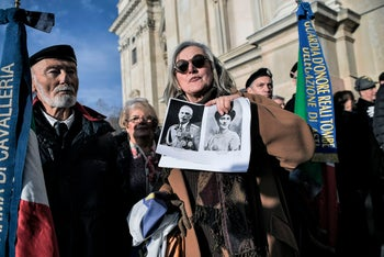 People pay tribute to Victor Emmanuel III and his wife Queen Elena of Montenegro at the Regina Montis Regalis Sanctuary in Vicoforte, December 18, 2017.