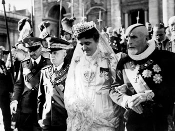 Queen Elena and King Victor Emmanuel III (right) of Italy leave Vatican city after an official visit to Pope Pie XII, December 26, 1939.