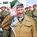 Yasser Arafat with Palestinian security forces in Gaza in 1995.