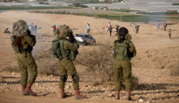 n this Nov. 17, 2016 file photo, Palestinians and Israeli activists run away from a tear gas fired by Israeli soldiers during a demonstration against the construction of Jewish settlements in the Jordan Valley, in the West Bank. A former Israeli combat officer turned whistleblower has found himself in the fight of his lifetime, leading a campaign against Israelג€™s occupation of the West Bank and drawing relentless criticism from the countryג€™s leaders who have labeled him a traitor.