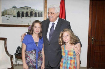 Tamimi (right) and Palestinian President Mahmoud Abbas, taken from Facebook.