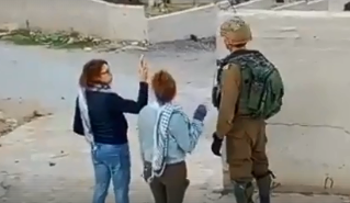 Ahed Tamimi and her cousin Nur Tamimi confronting soldiers in the West Bank village of Nebi Salah.