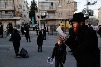 Ultra-Orthodox demonstrators in Mea She'arim, in Jerusalem, protesting the closure of a local synagogue, Dec. 12, 2015.
