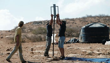 Israeli settlers start to build a new illegal outpost in the Jordan Valley, October 25, 2016.