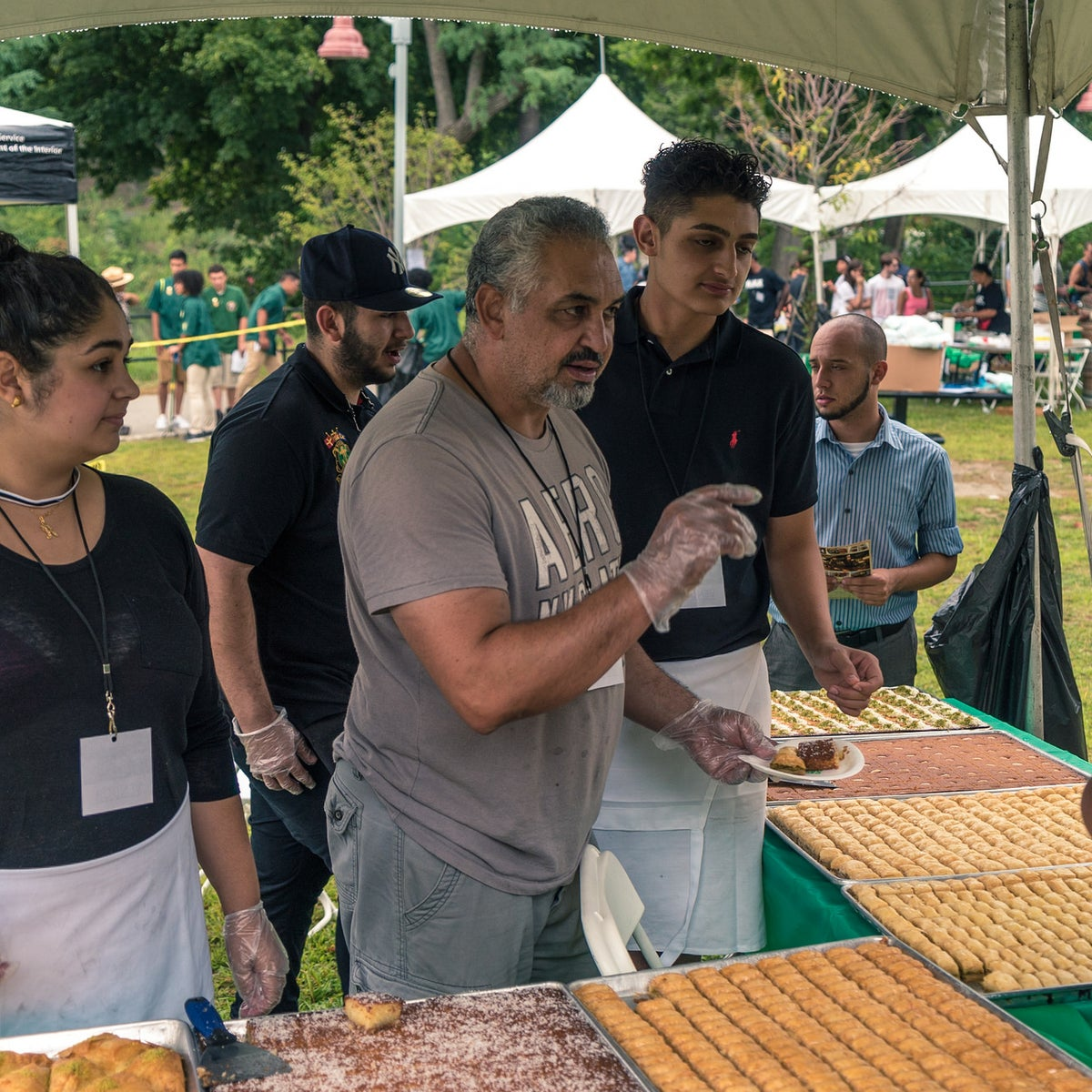 Members of the Nablus Sweets bakery during the centennial of the Great Falls Park, Paterson, NJ.