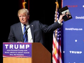 In this Aug. 19, 2015 file photo, Republican presidential candidate Donald Trump holds up a copy of his 1987 book, 'Trump: The Art of the Deal' during his campaign town hall event at Pinkerton Academy in Derry, N.H.
