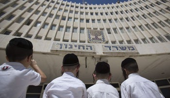 Ultra-Orthodox Jewish children outside the Education Ministry in Jerusalem.