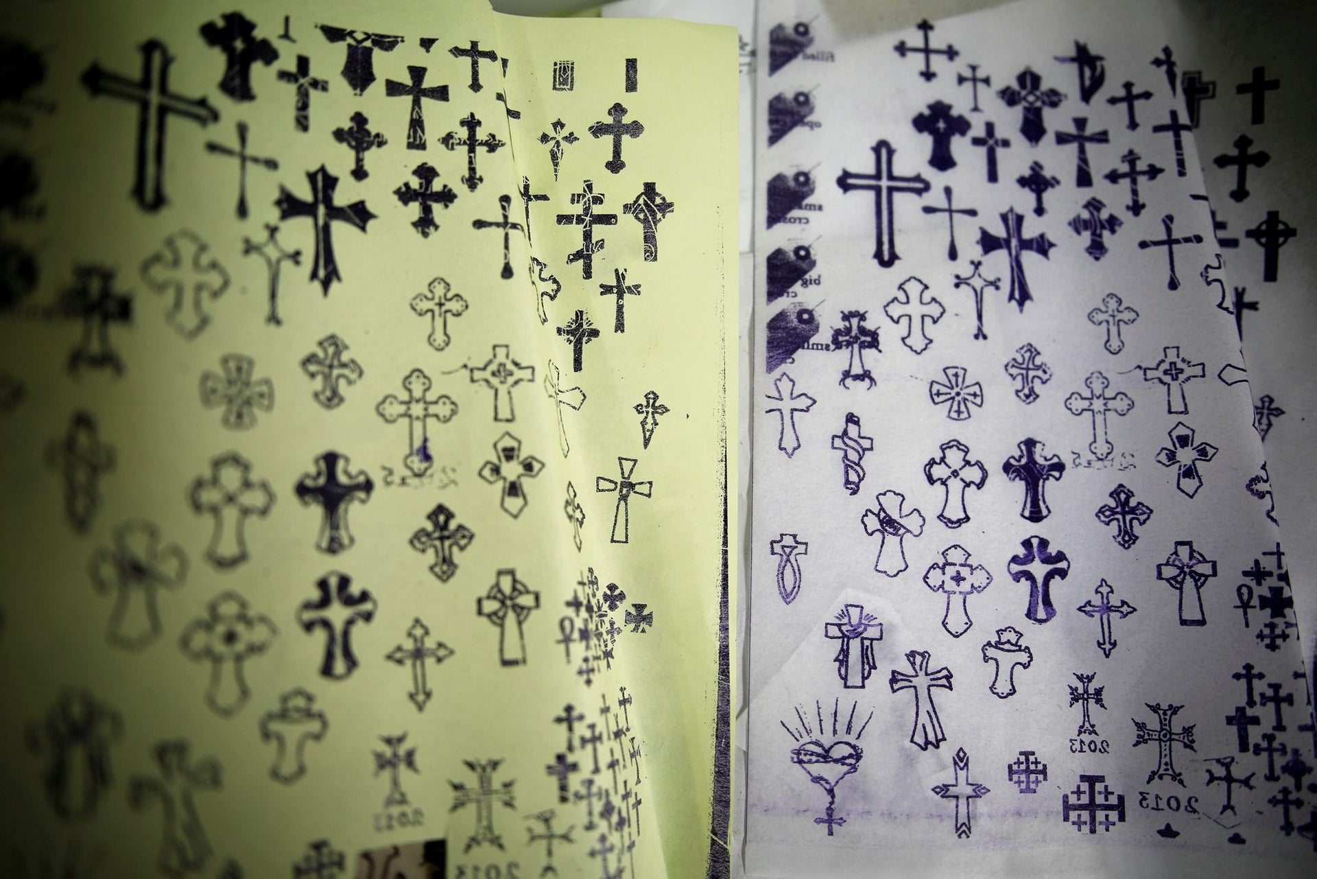 Pages displaying different Christian cross designs are seen at the studio of tattoo artist, Wassim Razzouk, who is continuing his family's tradition of inking Christian pilgrims with ancient tattoos, in Jerusalem's Old City November 27, 2017. Picture taken November 27, 2017.