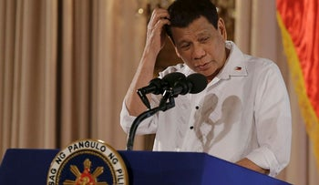 Philippine President Rodrigo Duterte scratches his head as he delivers a speech during the ceremonial signing of the 2018 General Appropriations Act and Tax Reform for Acceleration and Inclusion Bill at the Malacanang Presidential Palace in Manila, Philippines on Tuesday Dec. 19, 2017