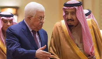 In this photo released by Al-Ekhbariya, Saudi King Salman, right, receives Palestinian President Mahmoud Abbas after he arrives in Riyadh, Saudi Arabia, Wednesday, Dec. 20, 2017
