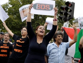 Pro-Palestinian protesters rally for BDS in Paris, in August 2015.