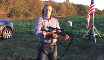 A screenshot of a video posted on Paul Nehlen's YouTube account shows Nehlen holding a gun.