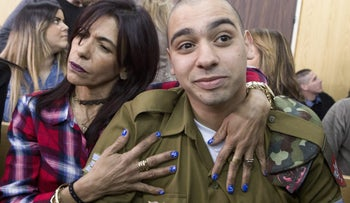 Elor Azaria being embraced by his mother at his sentencing hearing, Feb. 21, 2017.