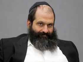 Sholom Rubashkin smiles during his trial at the Black Hawk County Courthouse on Tuesday, May 11, 2010 in Waterloo, Iowa.