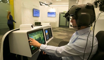 A man demonstrates wearing Elbit System's advanced helmet mounted system, at their offices in Haifa, Israel February 26, 2017.