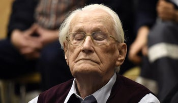 Convicted former SS officer Oskar Groening listening to the verdict of his trial in court in Lueneburg, Germany, July 15, 2015.