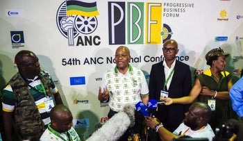 Jacob Zuma, South Africa's president and Zizi Kodw, national spokesman for the African National Congress party, at the 54th national conference of the African National Congress party in Johannesburg, South Africa on December 18, 2017.