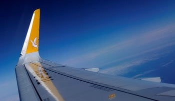 FILE PHOTO: Logo of the Turkish budget airline Pegasus is pictured on the wing of an Airbus A320-200 aircraft after it took off from Sabiha Gokcen International airport in Istanbul, Turkey March 5, 2016.