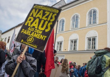 Anti-Nazi protesters outside the house where Adolf Hitler was born, which authorities decided in 2016, after years of bitter legal wrangling, to demolish to stop it becoming a neo-Nazi shrine. Braunau Am Inn, Austria. April 18, 2015