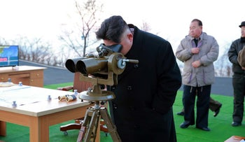 North Korea's leader Kim Jung-Un supervises the launch of four ballistic missiles. Date unknown.