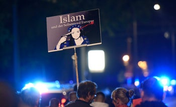 Anti-Muslim protestors hold up a sign depicting 'Islam: The suicide of Europe' during a demonstration of PEGIDA (Patriotic Europeans against the Islamization of the West) in Dresden, eastern Germany. Oct. 5, 2015