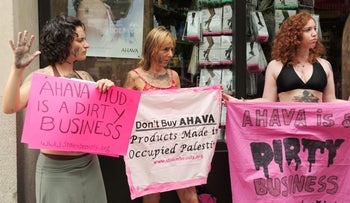 """When politics colors business: Protesting Ahava products in Washington, DC, on July 29, 2009. Ahava manufactures skin-care products from the Dead Sea, but """"Code Pink"""" claim the products are made with Palestinian natural resources"""