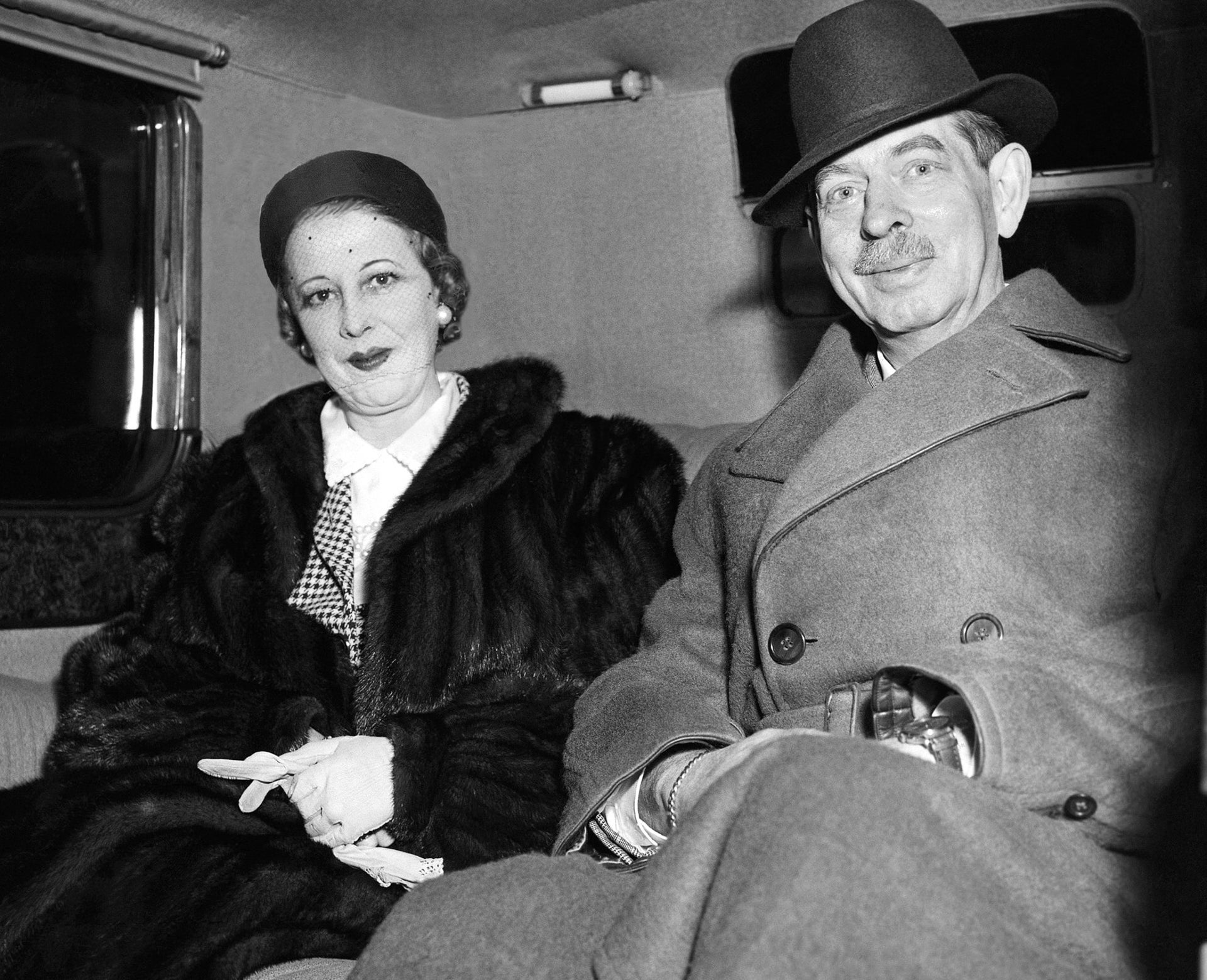 Ex-King Carol II of Romania and his wife, Elena Lupescu, are pictured outside Claridges Hotel in London, Dec.6, 1951 They arrived at Tilbury yesterday on a surprise visit to England.