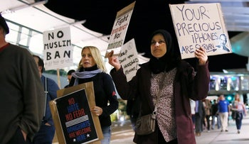 Protesters chant during a rally against Trump's new travel ban at San Diego International Airport, March 6, 2017.