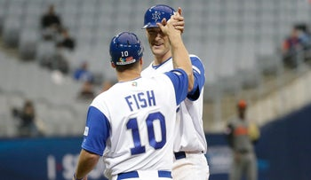 Israel's Nate Freima (R) celebrates with Nate Fish after hitting an RBI single against Netherlands's starting pitcher during at the World Baseball Classic in Seoul, South Korea, March 9, 2017.