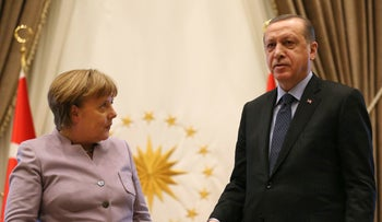 Turkish President Recep Tayyip Erdogan, right, and German Chancellor Angela Merkel leave at the end of a press statement after a meeting in Ankara, Turkey, Thursday, Feb. 2, 2017