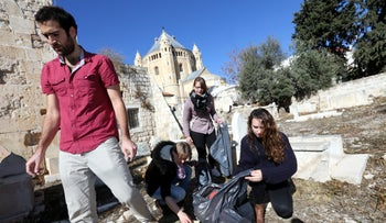 The cleanup operation at the Muslim cemetery on Jerusalem's Mount Zion.