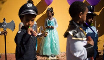 Asylum seeker children, mostly from Eritrea, wear costumes during the Purim parade festival in Tel Aviv, Israel, Wednesday, March 8, 2017. The Jewish holiday of Purim commemorates the Jews' salvation from genocide in ancient Persia, as recounted in the Book of Esther, which is read in synagogues. Other customs include: sending food parcels and giving charity; dressing up in masks and costumes; eating a festive meal; and public celebrations.