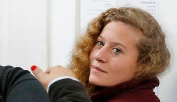 Palestinian protester Ahed Tamimi, right, appears at that military court at Ofer Prison in the West Bank, December 20, 2017.