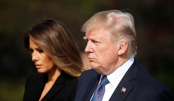 U.S. President Donald Trump, right, and first lady Melania Trump, left, arrive at the National Cemetery in Seoul, South Korea, Wednesday, Nov. 8, 2017.