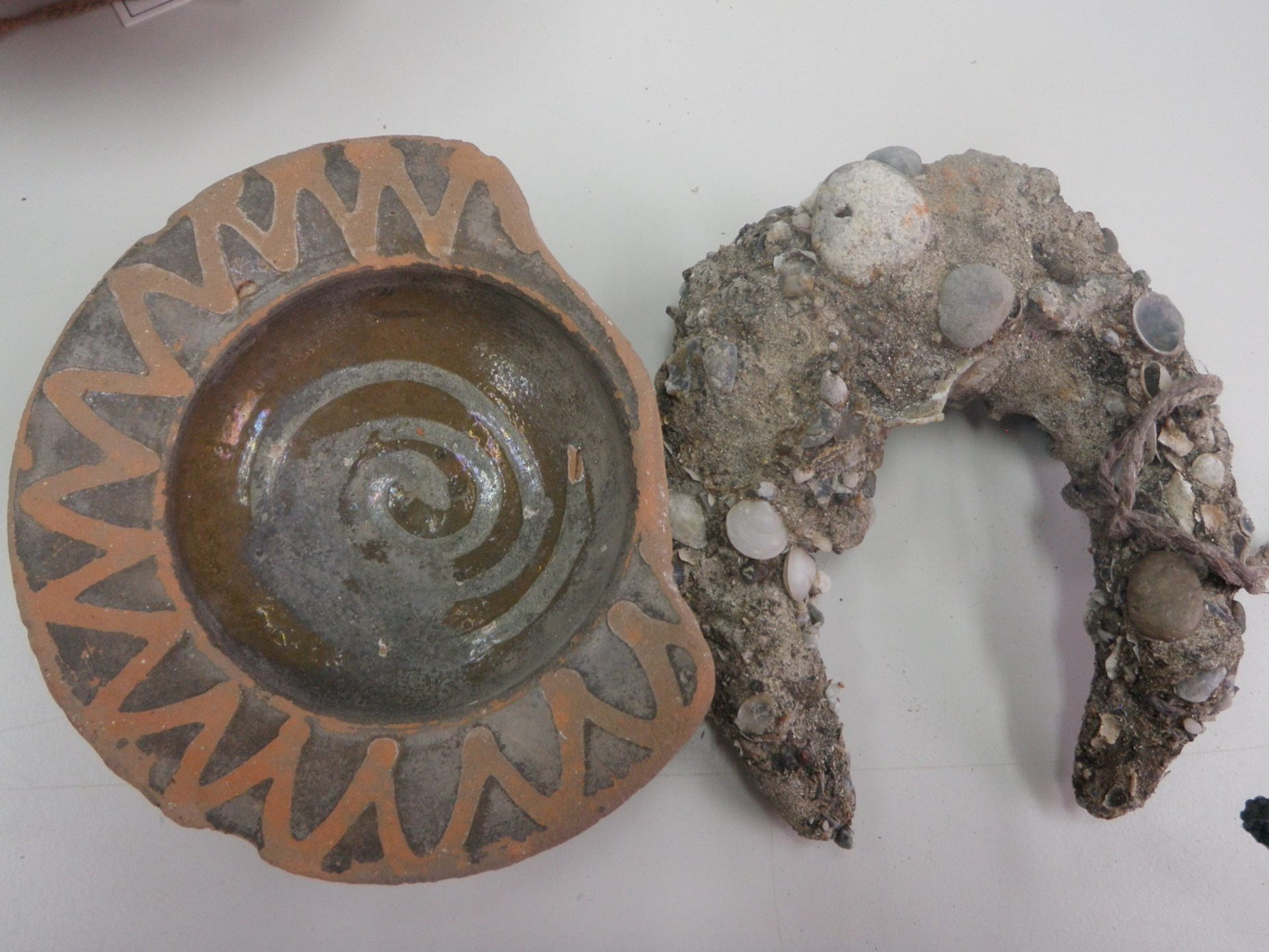 Glazed Crusader bowl and horseshoe, imported from Europe, found in Acre.