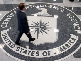 File Photo: A man walking over the seal of the CIA in Virginia. August 13. 2008.