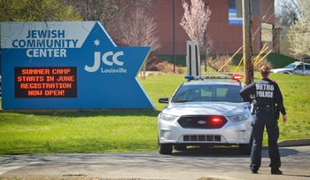 Officials respond to a bomb threat at the Jewish Community Center in Kentucky. March 8, 2017.