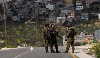 File Photo: Israeli soldiers man a temporary checkpoint outside a West Bank Palestinian village, 2011.