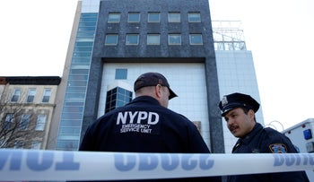New York City Police (NYPD) officers stand outside The Jewish Children's Museum following a bomb threat in Brooklyn, on March 9, 2017.