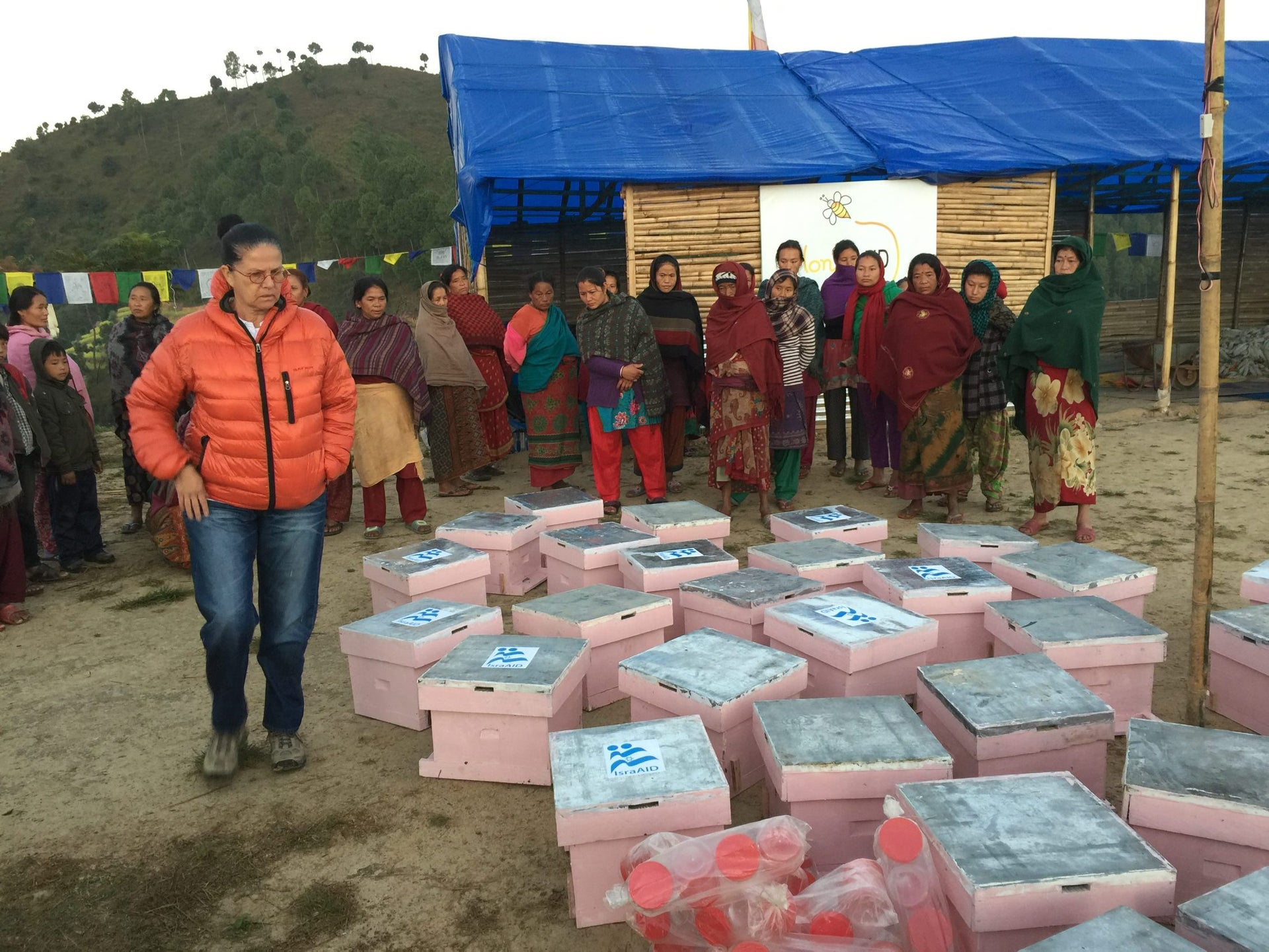 Reizy Dagani oversees distribution of the new beehives as part of the HoneyAID female empowerment project in Nepal.