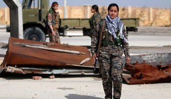 Laila Sterk, 22, a Syrian Democratic Forces (SDF) female fighter, posing for a photograph in the northeastern Syrian city of Hasaka, Syria, February 26, 2017.