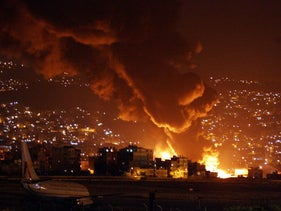 Fuel tanks burn at the Beirut international airport after it was attacked by Israeli aircraft July 13, 2006.