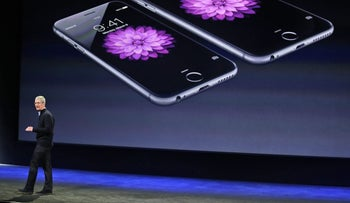 Apple CEO Tim Cook talks about the iPhone 6 and iPhone 6 Plus during an Apple event in San Francisco, March 9, 2015.