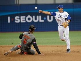 Israel's Scott Burcham throws to first for a double play as Netherlands's Jonathan Schoop slides into second base during their WBC game in Seoul, South Korea, Thursday, March 9, 2017.
