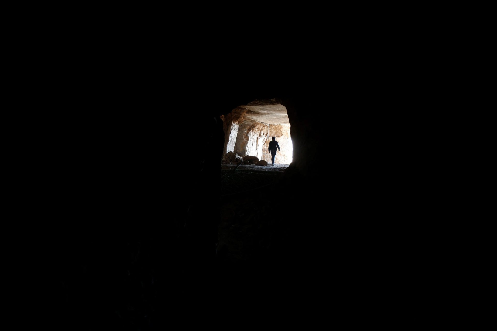 A man walks in a tunnel network running under the Mosque of Prophet Jonah, Nabi Yunus in Arabic, in eastern Mosul, Iraq, March 9, 2017.