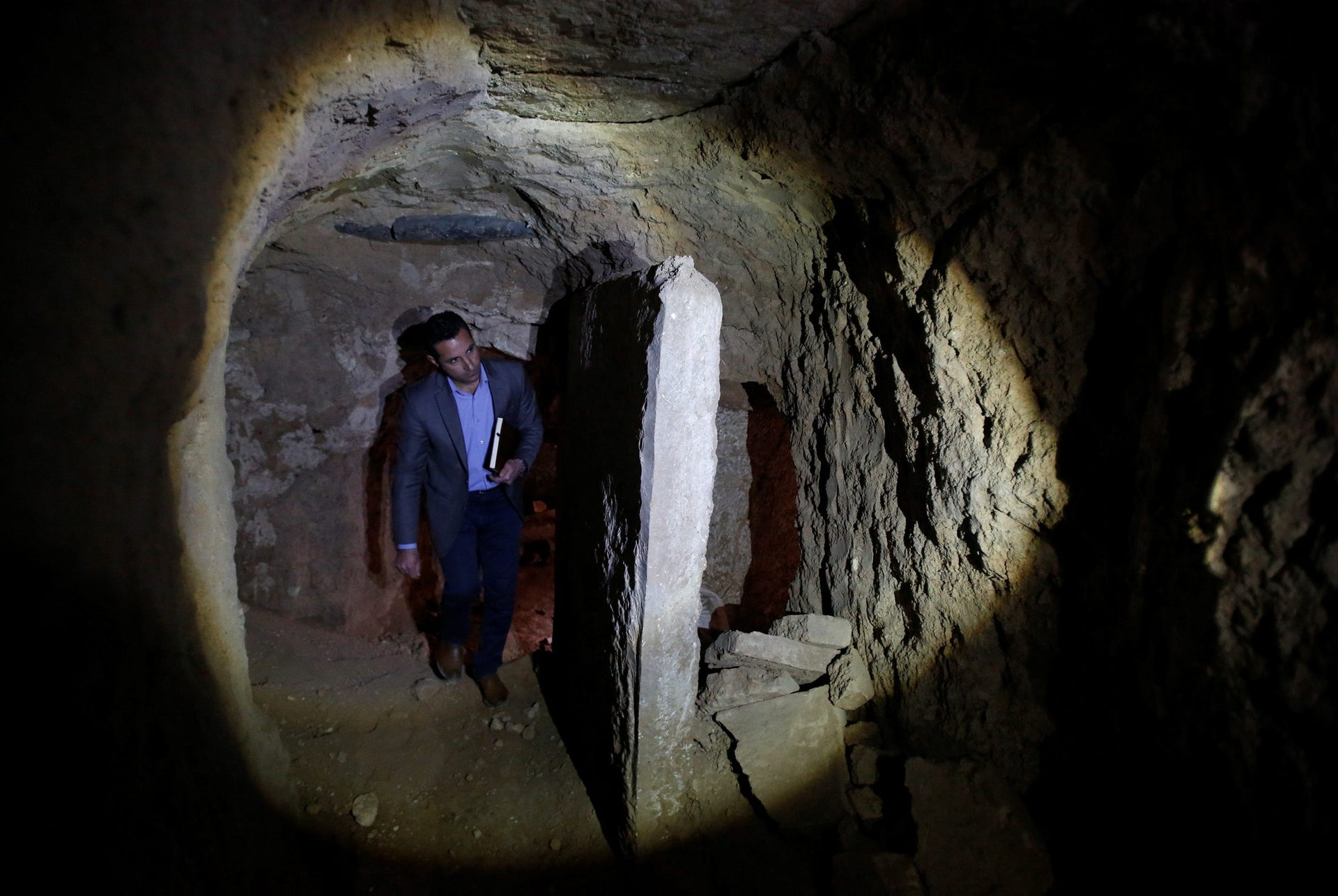 Archaeologist Musab Mohammed Jassim shows artifacts and archaeological pieces in a tunnel network running under the Mosque of Prophet Jonah, Nabi Yunus in Arabic, in eastern Mosul, Iraq, March 9, 2017.