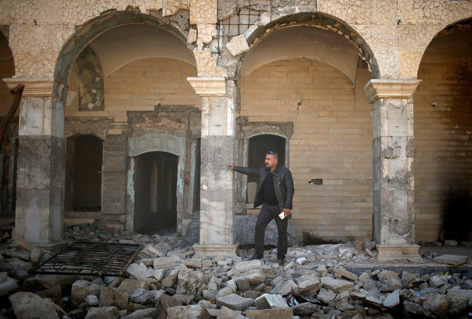 An Iraqi man looks at a destroyed tomb of the Prophet Jonah (Nabi Younes) in the eastern side of Mosul, Iraq, March 9, 2017.